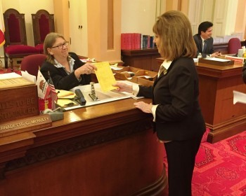 Senator Bates (right) officially introduced SB 902 to Bernadette McNulty, the Chief Assistant Secretary of the Senate